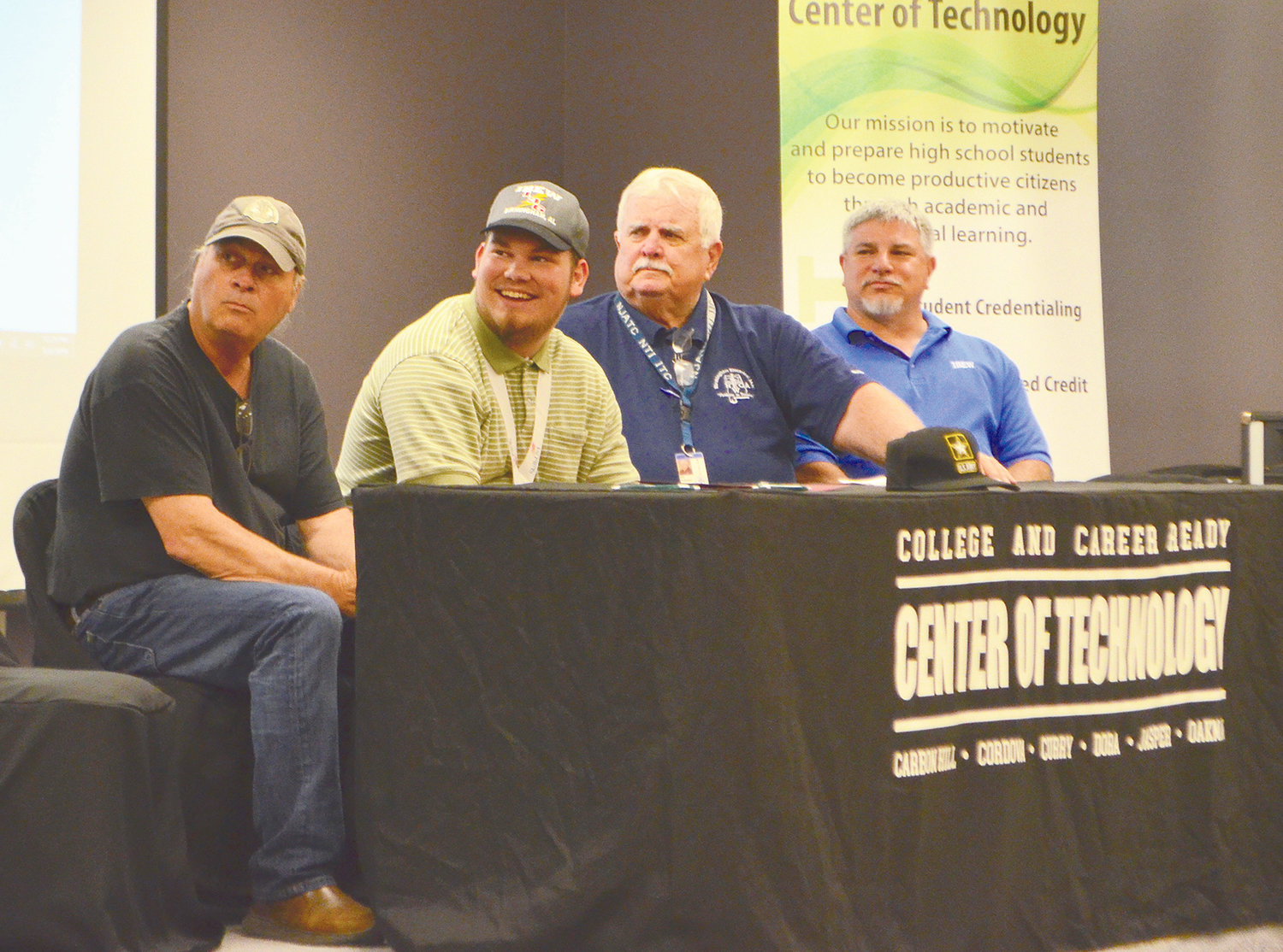 Dora High School's Nathaniel Clark, second from left, signed with International Brotherhood of Electrical Workers Thursday.