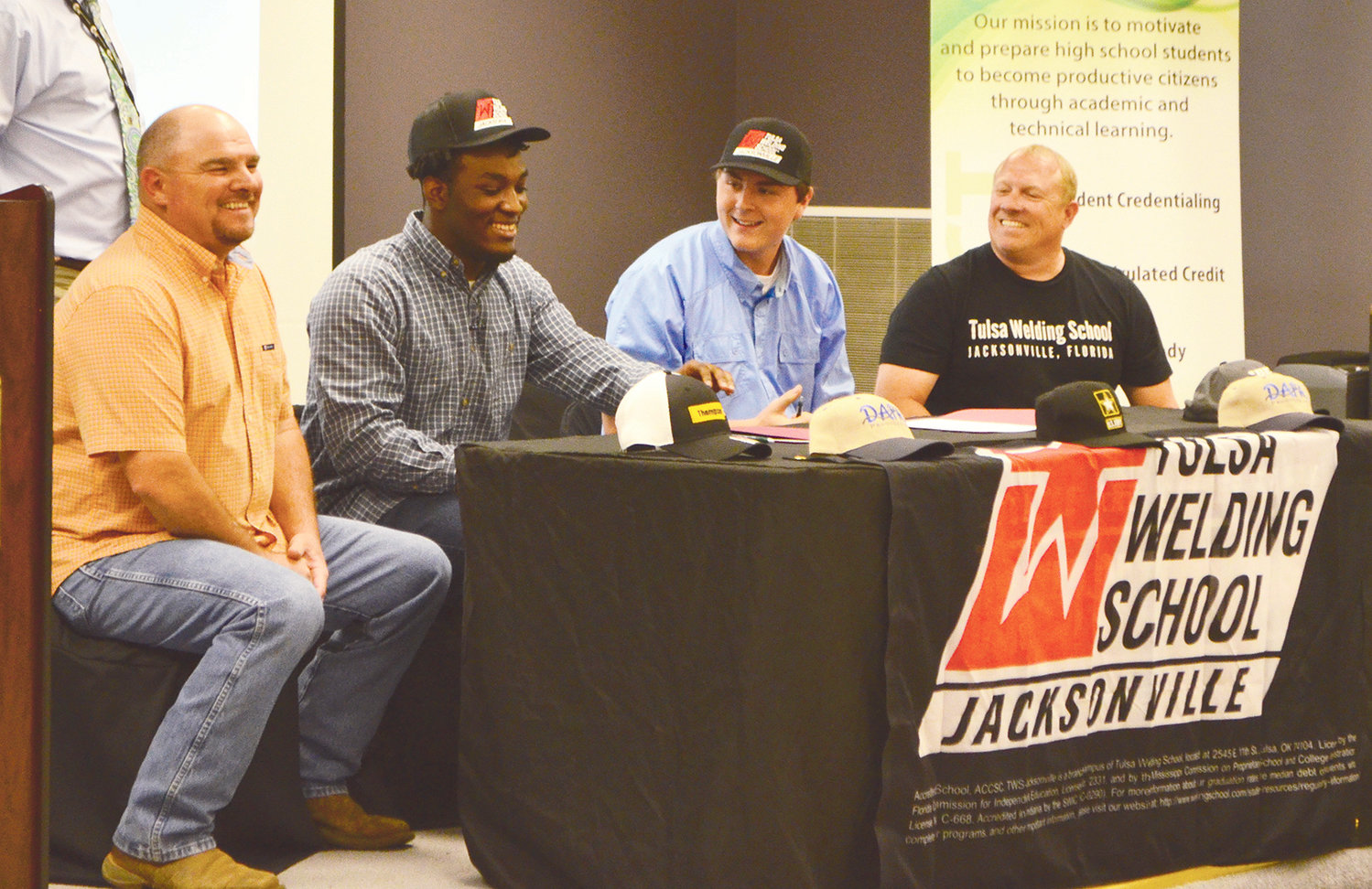 At center, Cameron Lambert (Jasper High) and Cody Hall (Carbon Hill High) signed with Tulsa School of Welding at the Walker County Center of Technology's signing day Thursday.