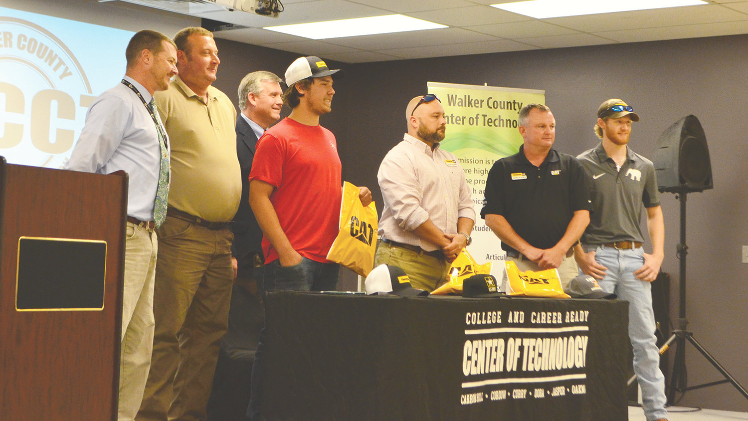 Oakman High School's Kobe Mitchell, third from left, signed with Thompson Tractor on Thursday.