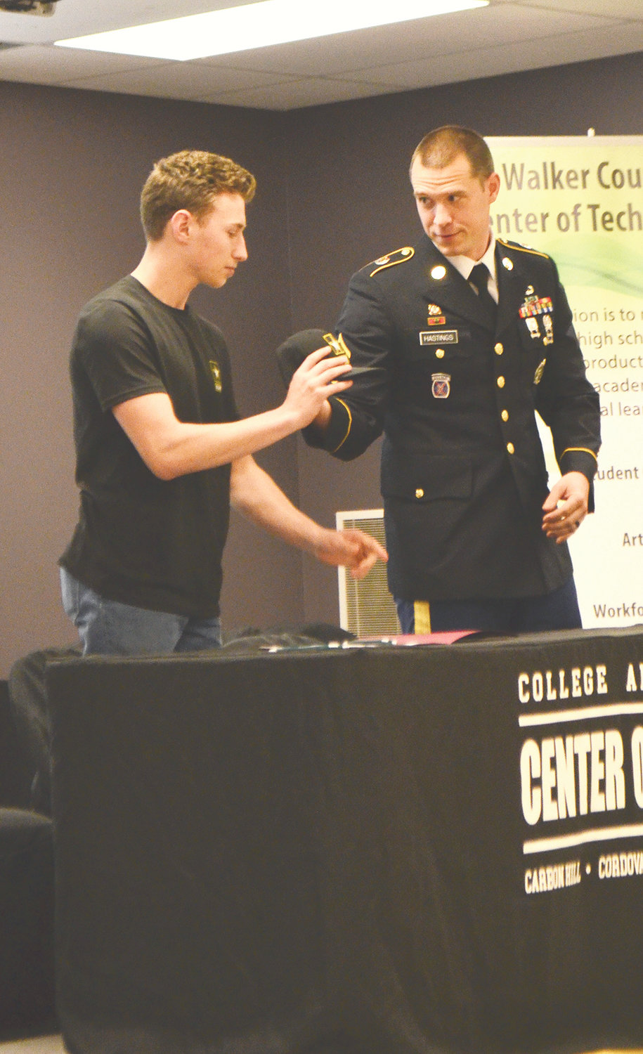 Caleb Romano of Dora High School signed with the U.S. Army on Thursday.