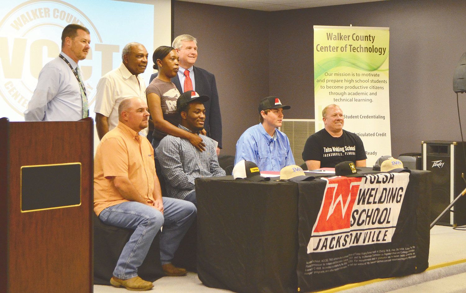 A group shot is taken as Cameron Lambert of Jasper High School and Cody Hall of Carbon Hill High School sign with Tulsa School of Welding on Thursday.