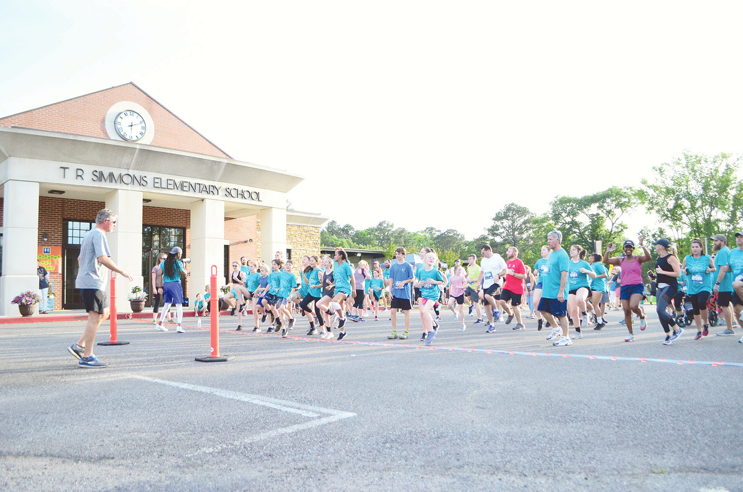 Rain held off for the Simmons @ Sunset 5K and Fun Run Friday night. Hundreds gathered for the annual event that takes runners around Jasper and raises money for T.R. Simmons Elementary School. Others gathered for fun and food on the school's campus Friday.