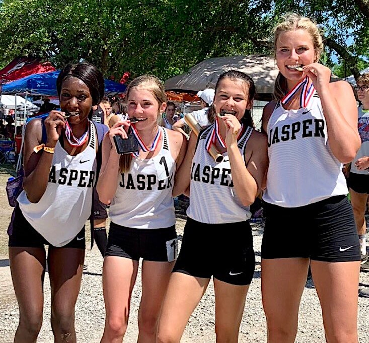 Jasper High School's 4x800-meter relay team of Makenna Lewis, Maci Beaty, Anna Mobley and Carlee Muncher won gold at the State Track Meet on Friday.