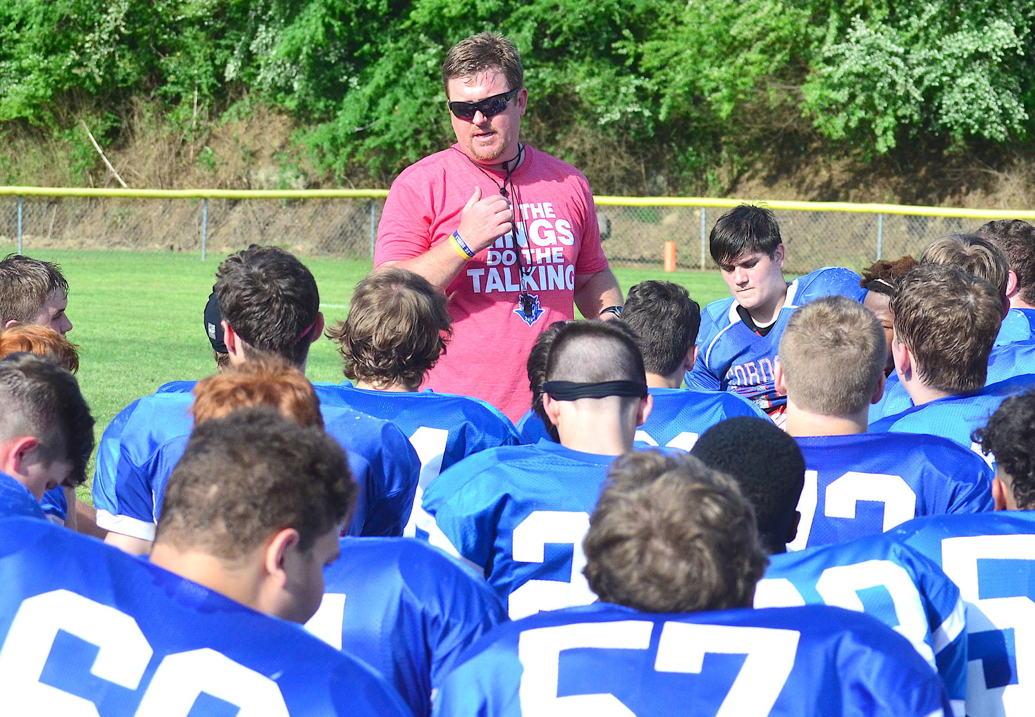 New Cordova High School football coach Justin Jones talks to players after practice on Thursday. The Blue Devils have more than 60 varsity players going through spring practice. The team is playing a spring game vs. W.S. Neal at the Troy University football field at 3 p.m. on May 18.