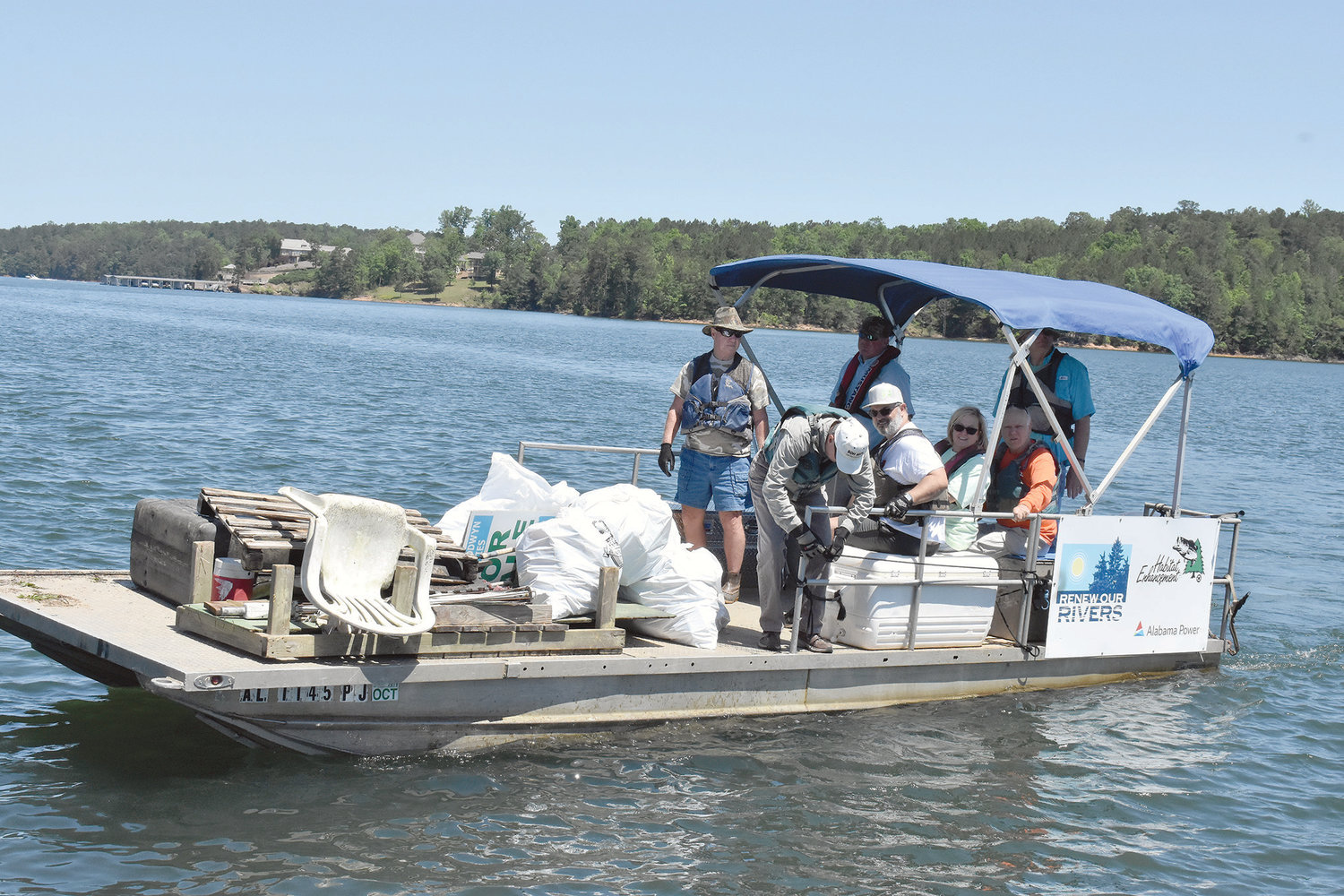This boat brings in more garbage and litter picked up at Smith Lake Monday as part of a two-day cleanup that continues today.