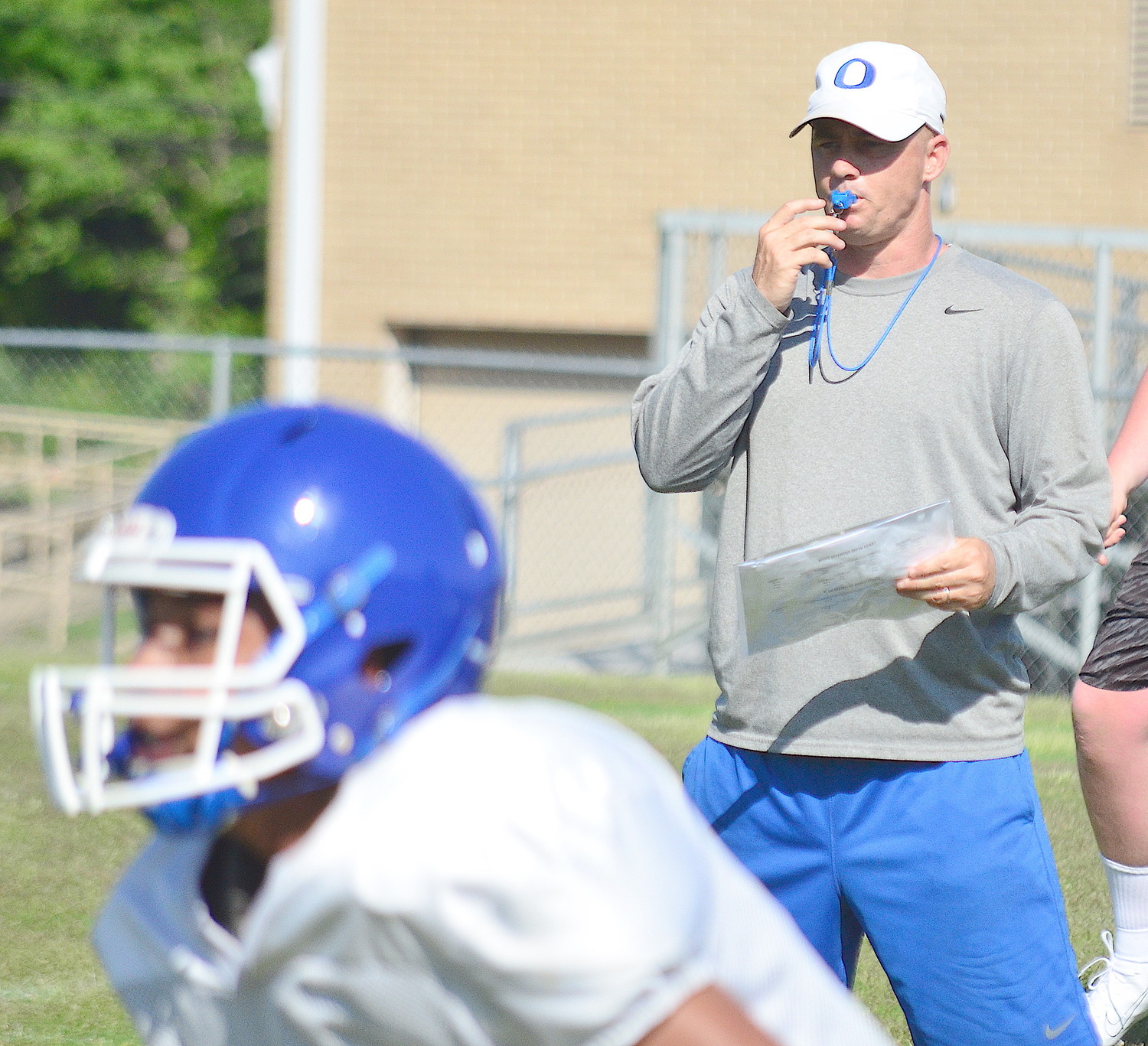 Oakman football coach Ryan Hall looks on during practice at the school earlier this week.