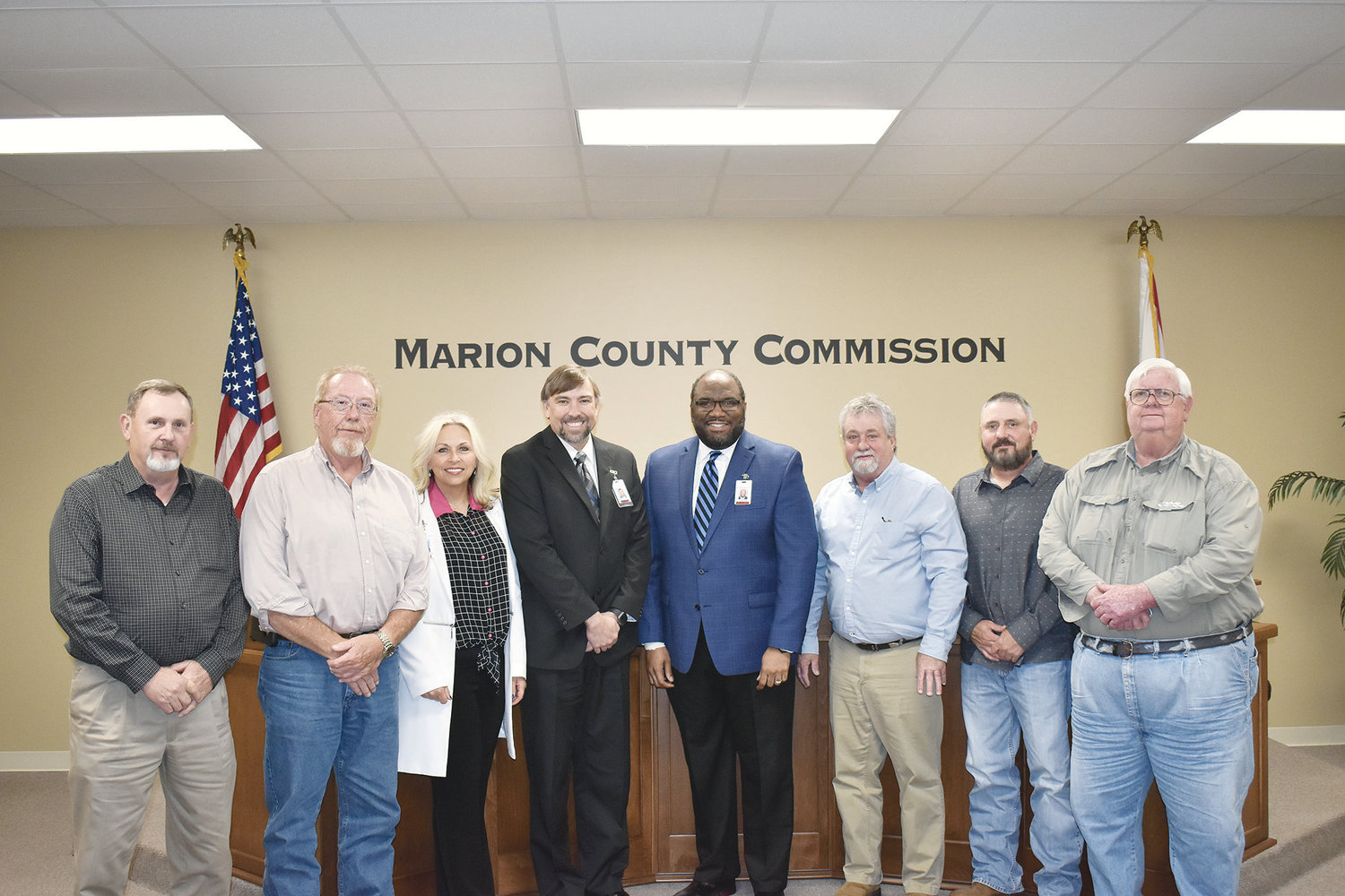 Bevill State Community College leaders are pictured with members of the Marion County Commission after signing a memorandum of agreement regarding the college's new truck driver training program in Hamilton.