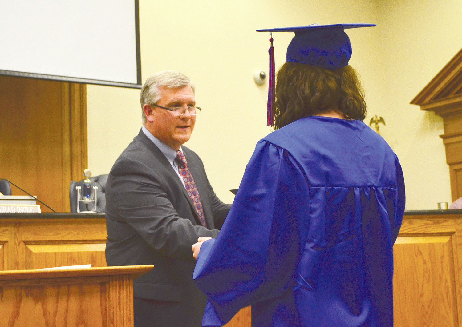 Superintendent Dr. Joel Hagood honors a student at the Hope and Twilight graduation Thursday.