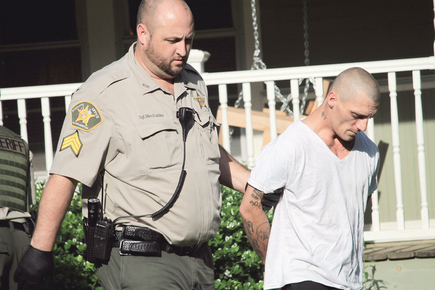 Jason Mechalske escorts Woody Frost to the van that will transport him to Walker County Jail on Wednesday.
