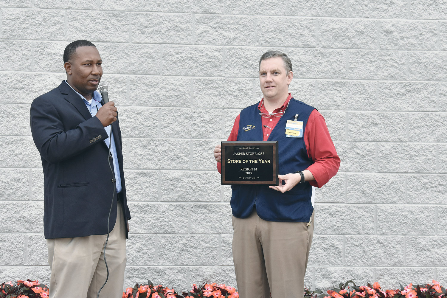 "The Walmart Supercenter in Jasper on Friday held a grand re-opening and ribbon cutting after its 12-week remodeling project, which features expanded departments and a new grocery pickup service. Long-time employee Teresa Eads, who also sang the National Anthem, was allowed to cut the ribbon. District Manager Brandon Garth presented a plaque to store manager Chris Rhodes as the store was the Region 14 Store of the Year for 2019. Rhodes thanked customers for their patience, noting, ""This remodel has been very successful."" Jasper Mayor David O'Mary reminded the crowd that the local Walmart was the first to open in Alabama in 1979. ""You have made a tremendous impact on Jasper, Alabama,"" he said."