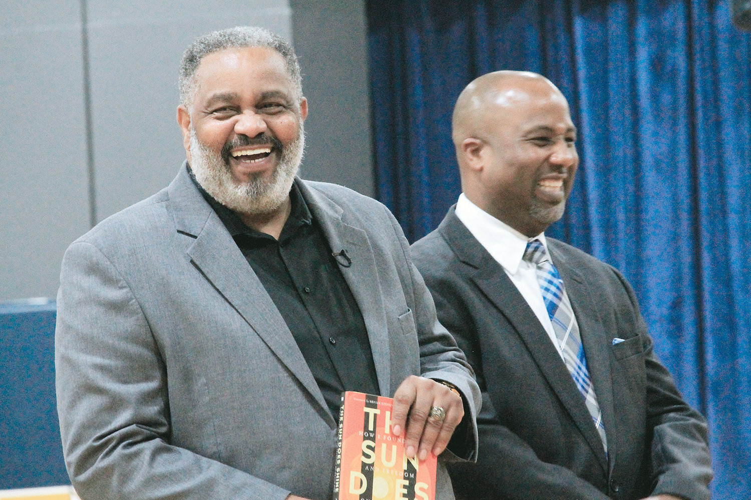 Anthony Ray Hinton and Dora High School Assistant Principal Yohance Prioleau laugh at a joke following Hinton's presentation at Dora High on Wednesday.