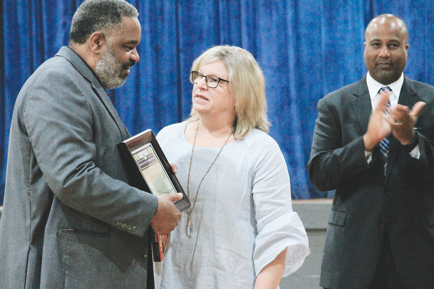 Dora Principal Paige Abner presents a certificate of appreciation to Anthony Ray Hinton on Wednesday after his presentation about spending 30 years on death row.