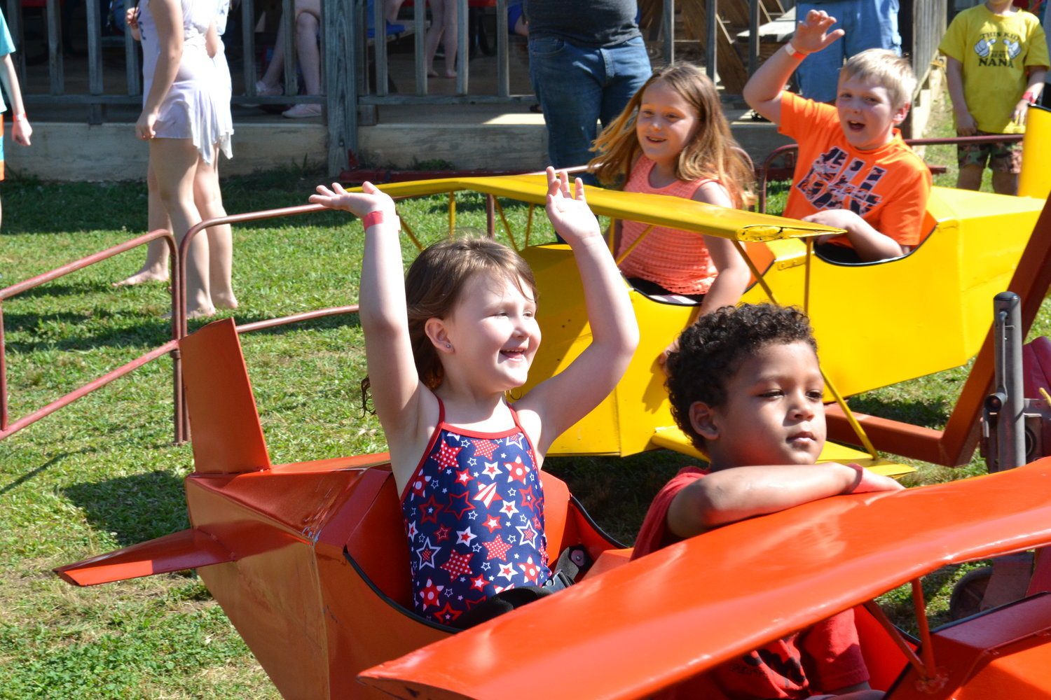 "Students taking flight on one of the rides at Cordova's annual ""May Day"" event."