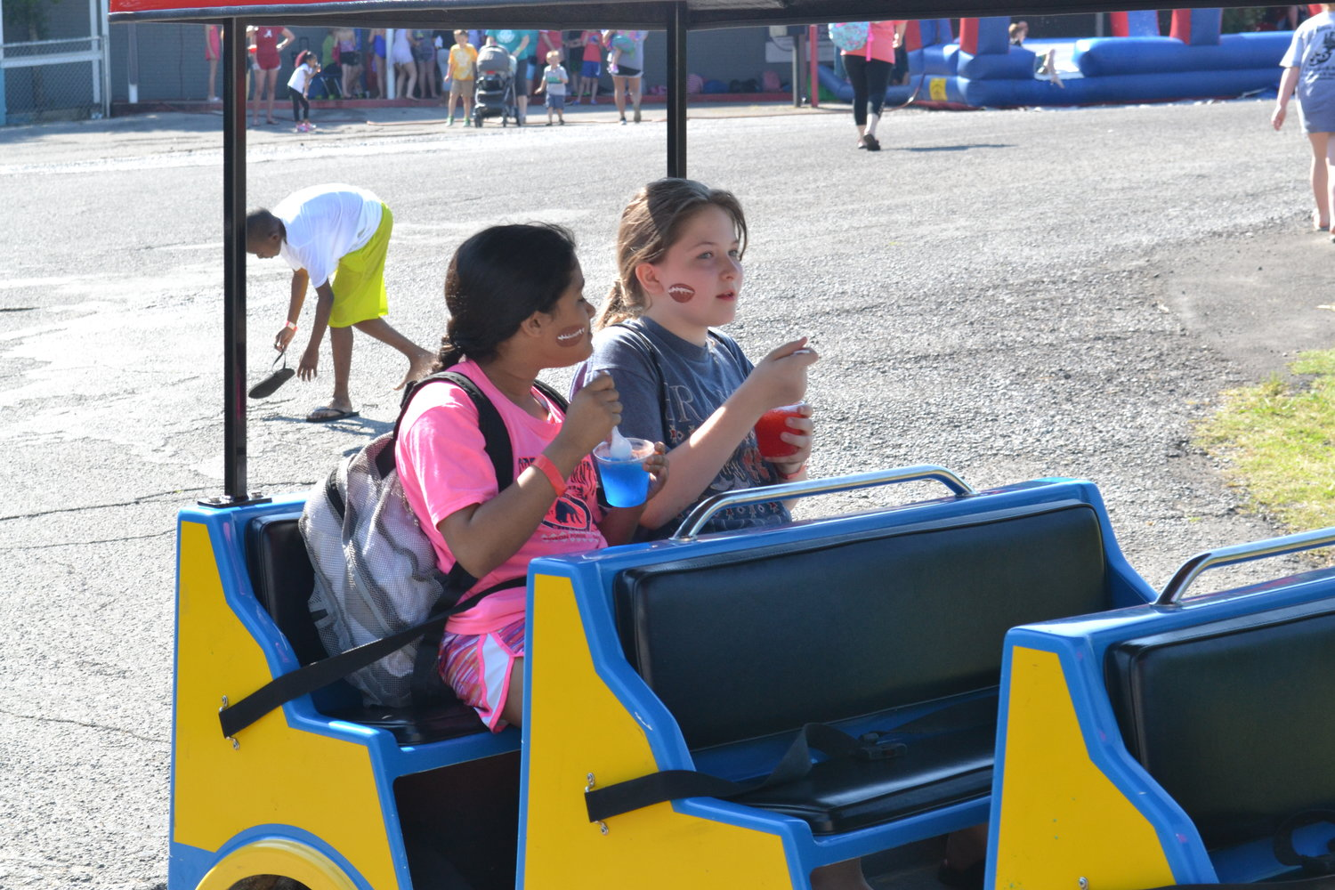 "Students getting out of the sun, enjoying a train ride and snow cones as part of Cordova Elementary's annual ""May Day"""