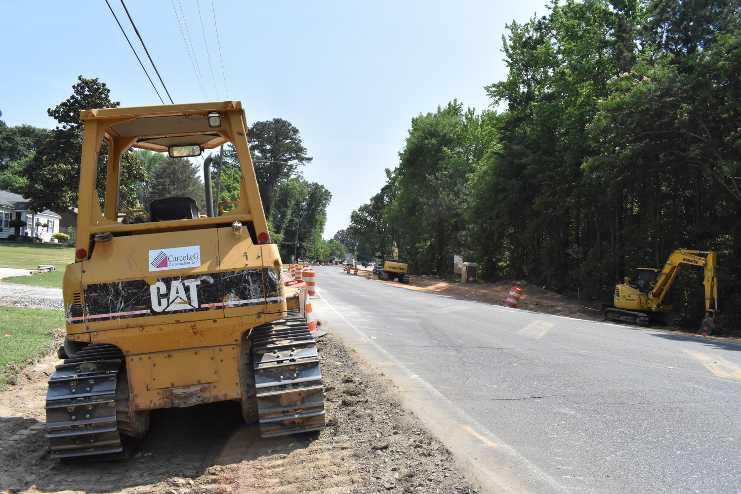 Heavy equipment and barrels line Airport Road in Jasper as crews work on the project to widen the road and put in more turning lanes.