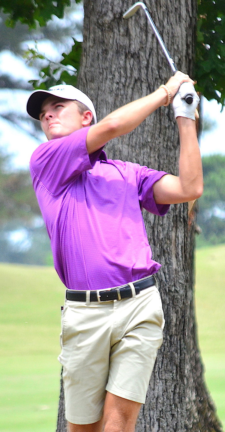 Jasper's Patrick Minor watches his tee shot on the ninth hole during the final round of the Pigeon Dove Junior Championship at Musgrove Country Club on Tuesday. Minor placed third in the boys championship flight, finishing seven strokes back of winner Avery Stansell.