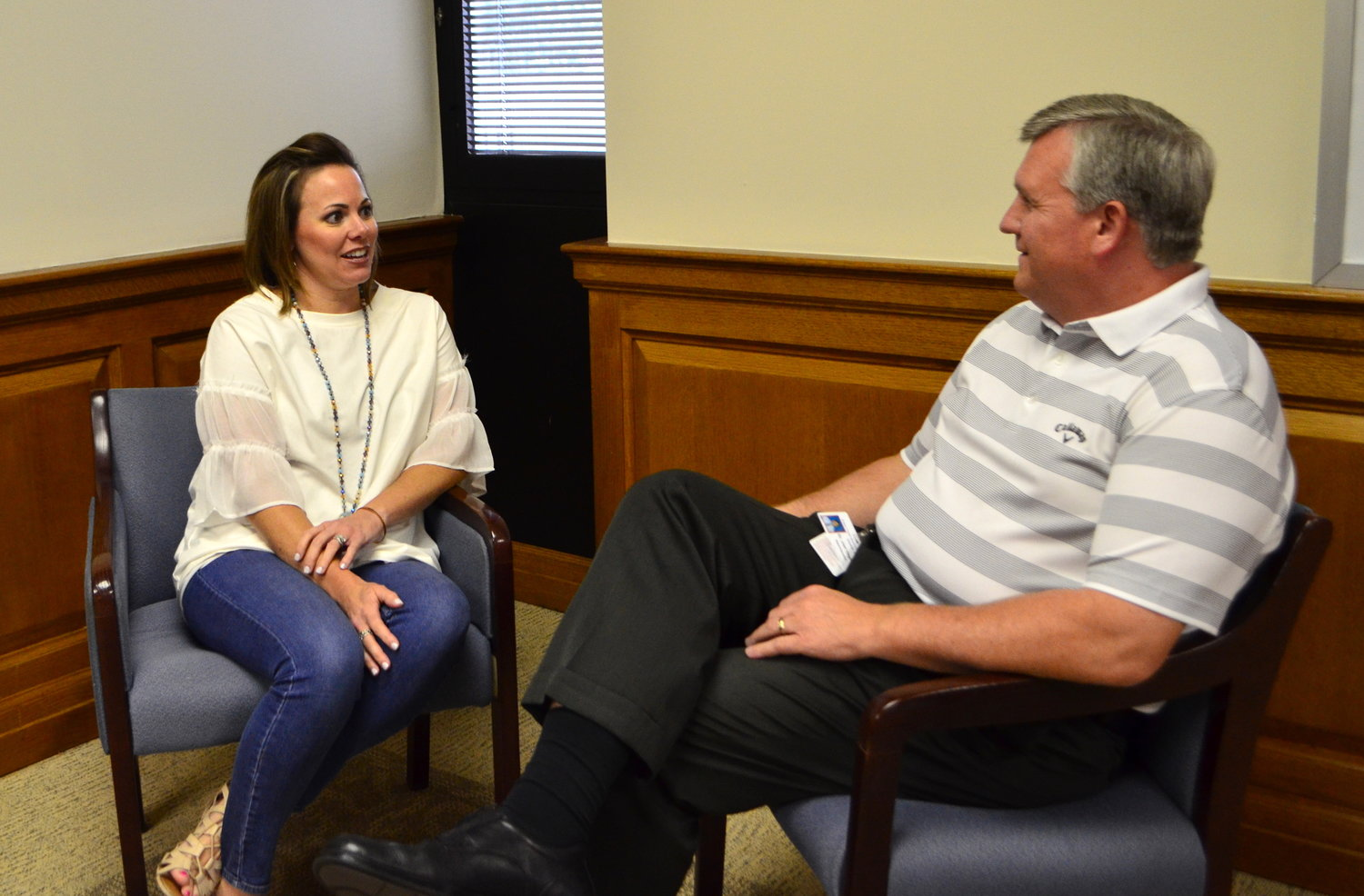 The Walker County Board of Education's new mental health coordinator, Misty Whisenhunt, and Superintendent Dr. Joel Hagood, have a discussion at the school system's central office on Thursday.