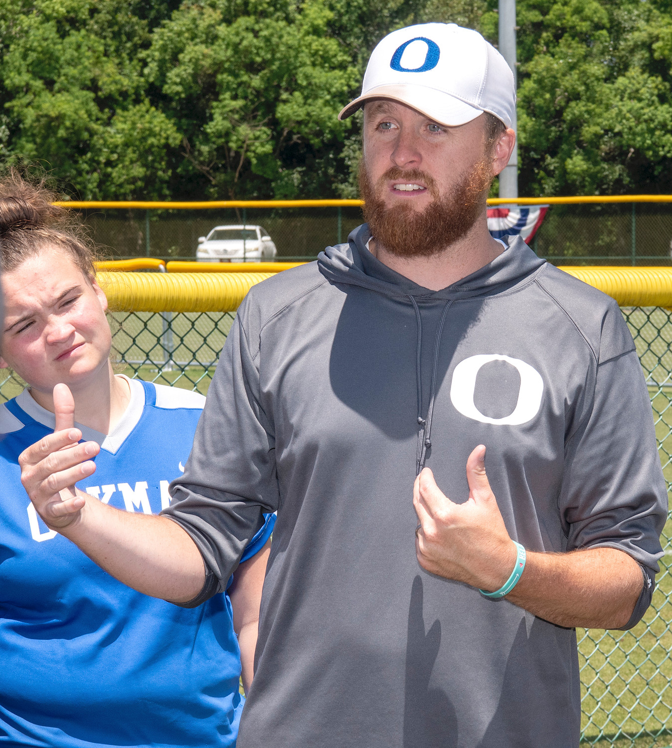 Oakman softball coach Jordan Burson talks to his team during the State Softball Tournament in Montgomery. Burson is the Eagle Elite Softball Coach of the Year.