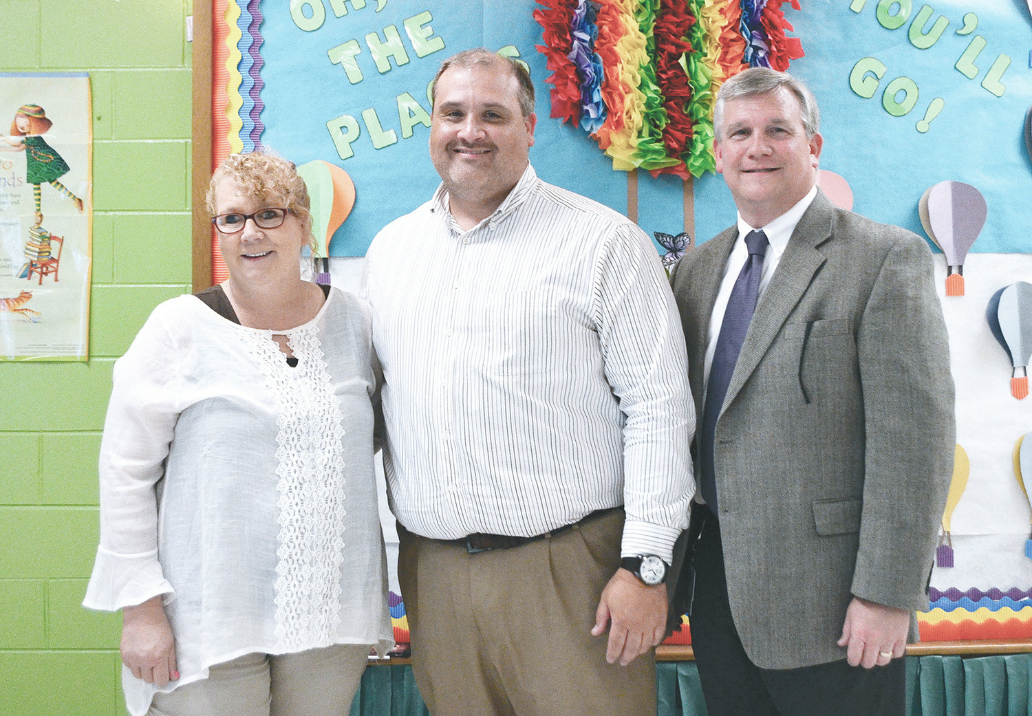 From left to right, Parrish Mayor Heather Hall, Parrish Elementary Principal Thomas Kyzer and Walker County Schools Superintendent Dr. Joel Hagood gather after the school board's vote Tuesday to add seventh grade to Parrish Elementary.