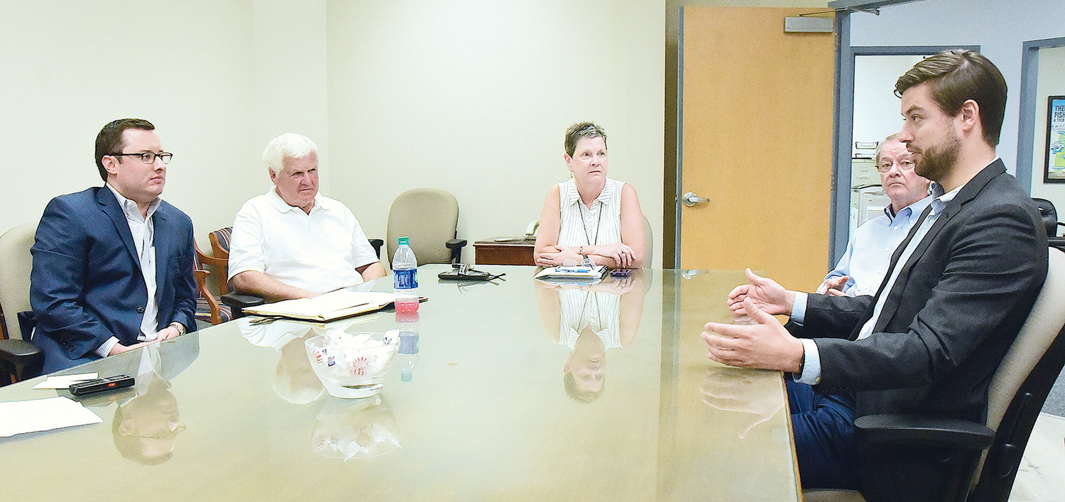 Clockwise, Jeff Sommer of Retail Strategies, Jasper Mayor David O'Mary, Chamber of Commerce of Walker County President Linda Lewis, Project Developer Carter Cooper of Richmomd Properties and Elliott Cook of Retail Strategies discuss the process of recruiting businesses to Jasper.