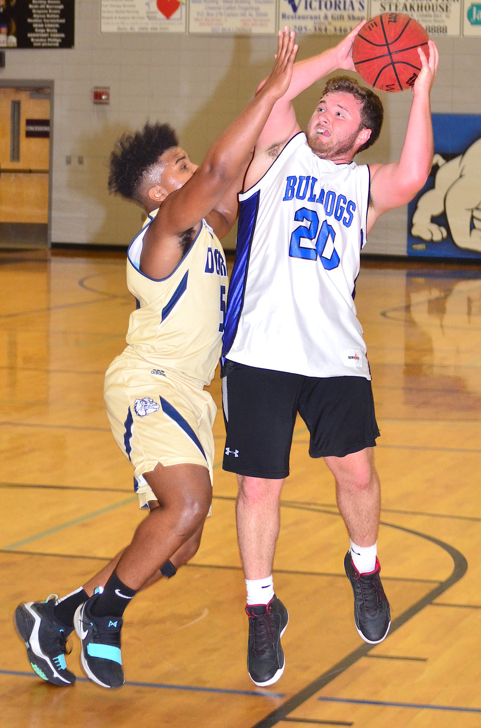 Carbon Hill's Jacob Aldridge (20) shoots over a Dora defender during their summer game at Carbon Hill High School on Tuesday. The home team won 53-40.