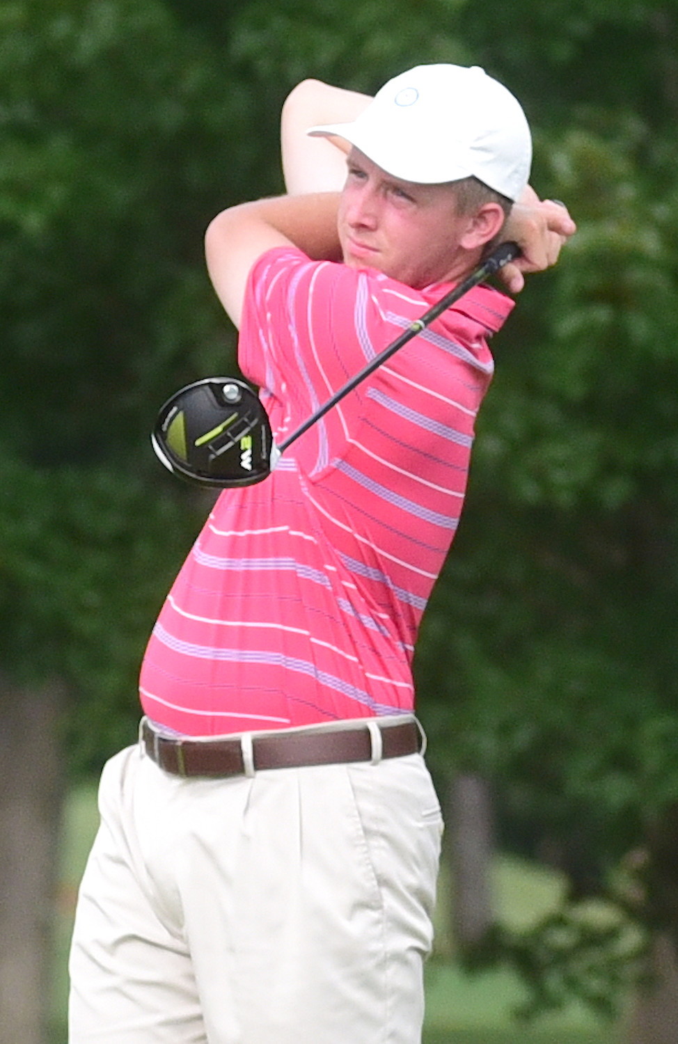 Falkville's Eli Marty watches his drive on the 17th hole during the final round of the 52nd annual Travis Hudson/Bernard Weinstein Invitational at Musgrove Country Club on Sunday. Marty won the tournament by three strokes.