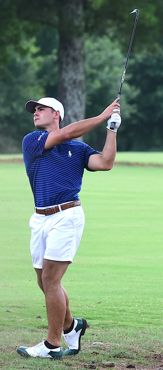 Birmingham's Sam Goldasich watches his shot on the 18th hole on Sunday.