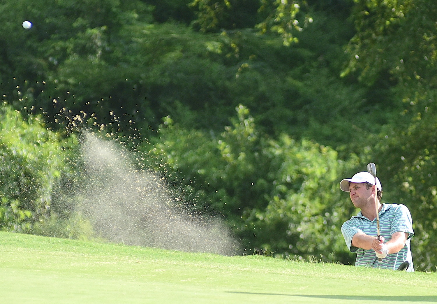 Hoover's Clay Guerin hits the ball out of a bunker on the final hole on Sunday.