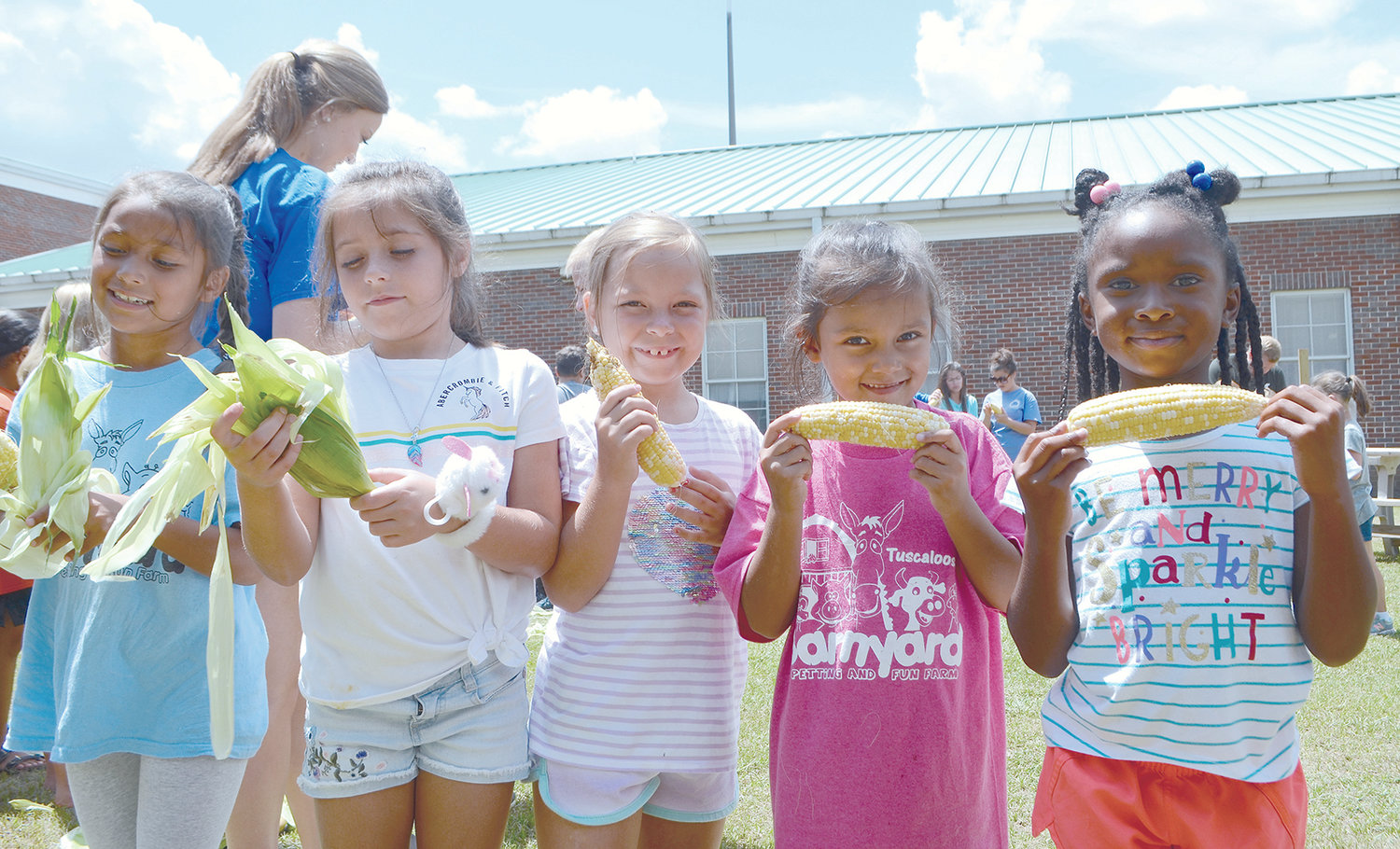 Carbon Hill Elementary students learned to shuck corn on Tuesday and enjoyed the vegetable for lunch as part of the Alabama Farm to School Program.