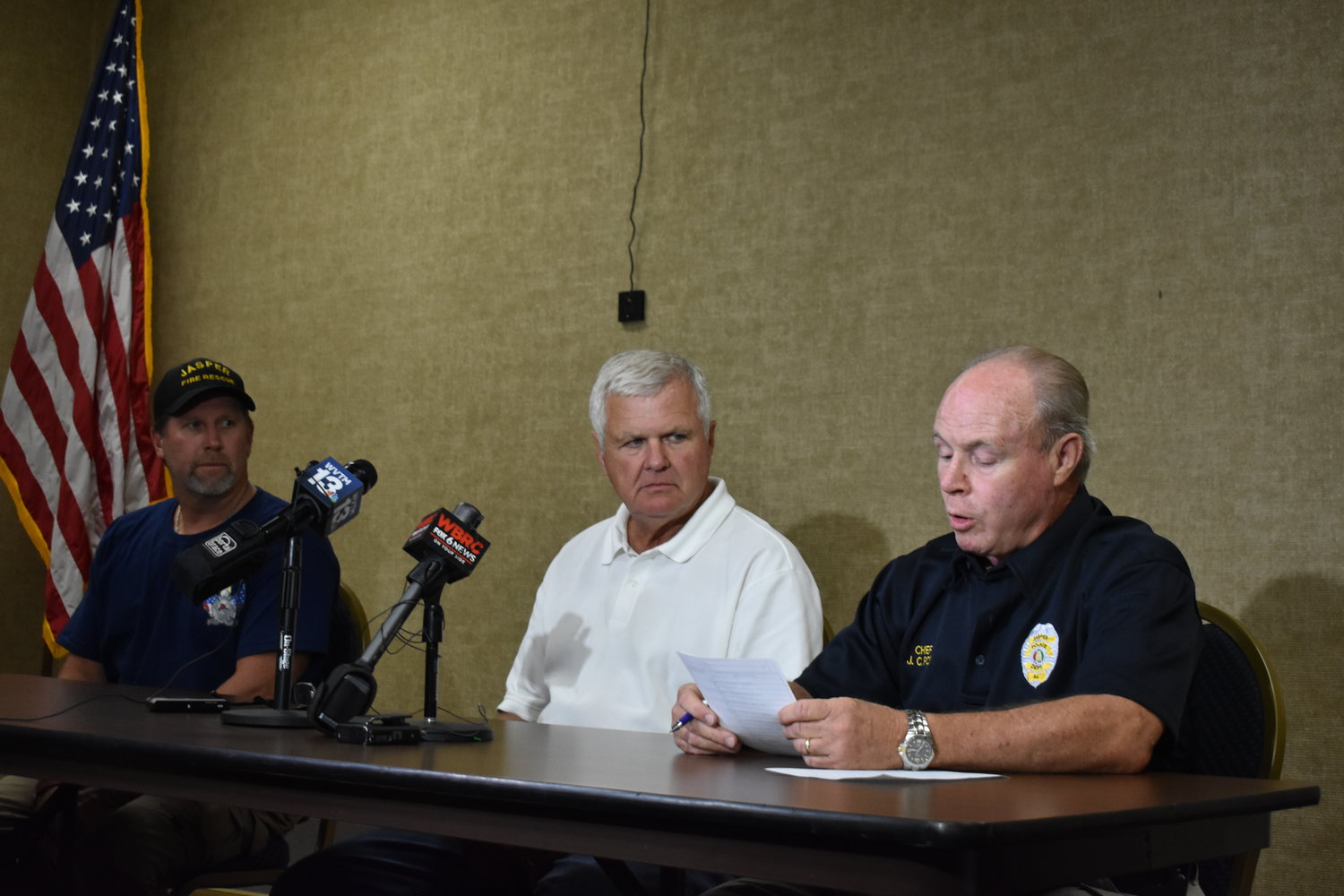 Jasper officials speak to the press Saturday night after a drowning of a 5-year-old girl at the Natatorium that afternoon. Shown, from left, are Fire Chief David Clark, Mayor David O'Mary, and Police Chief J.C. Poe.