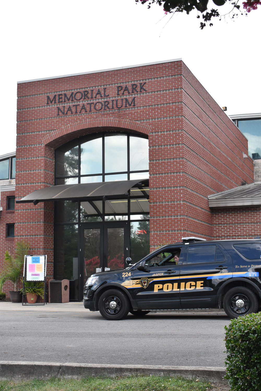 A police car sits outside the Memorial Park Natatorium late Saturday afternoon after a drowning victim was pulled out of a pool there. The 5-year-old victim was later pronounced dead at Walker Baptist Medical Center.
