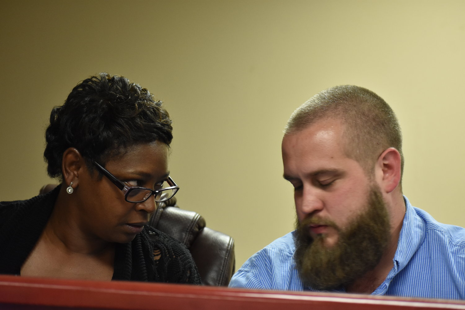 Councilwoman La'Tisha Oliver shares a word with Councilman Jake Williams during Tuesday's Parrish City Council meeting. The council picked Oliver to be the new mayor in the wake of Mayor Heather Hall's resignation.