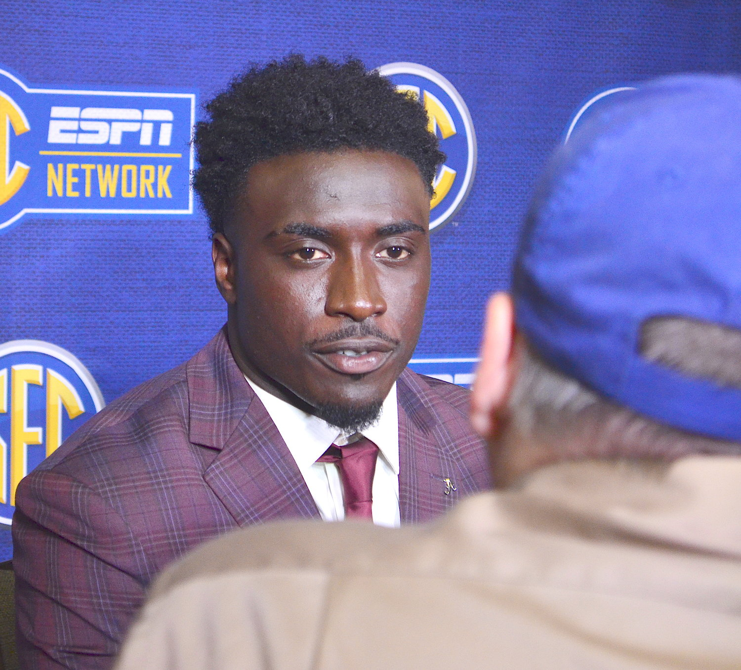 Alabama linebacker Dylan Moses speaks to reporters on Wednesday at SEC Media Days.