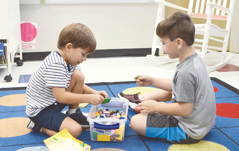 Two students work with building blocks at T.R. Simmons' kindergarten camp — all while developing their social skills.
