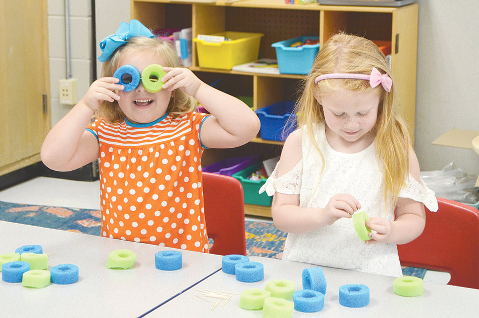 Two rising kindergartners participate in a STEAM activity at T.R. Simmons Elementary's kindergarten camp on Tuesday.