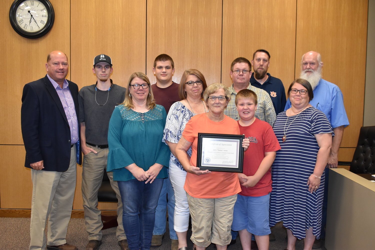 District 2 Walker County Commissioner Jeff Burrough, far left, presents a certificate of appreciation to the family of the late Danny Jones at Monday night's commission meeting. The award was given to honor Jones' community service to the Townley area.