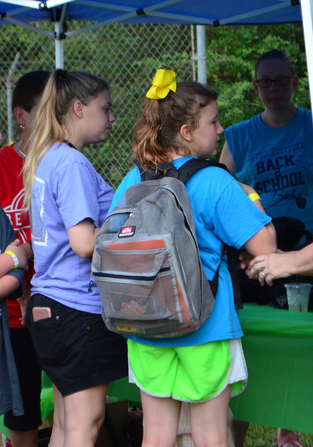 One girl receives a backpack filled with school supplies at Saturday's Back 2 School Bash in Dora.