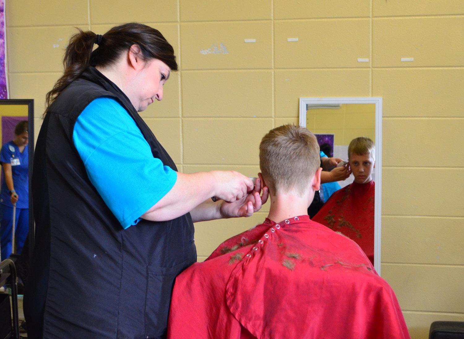 A boy gets a haircut on Saturday in preparation for the first day back to school.