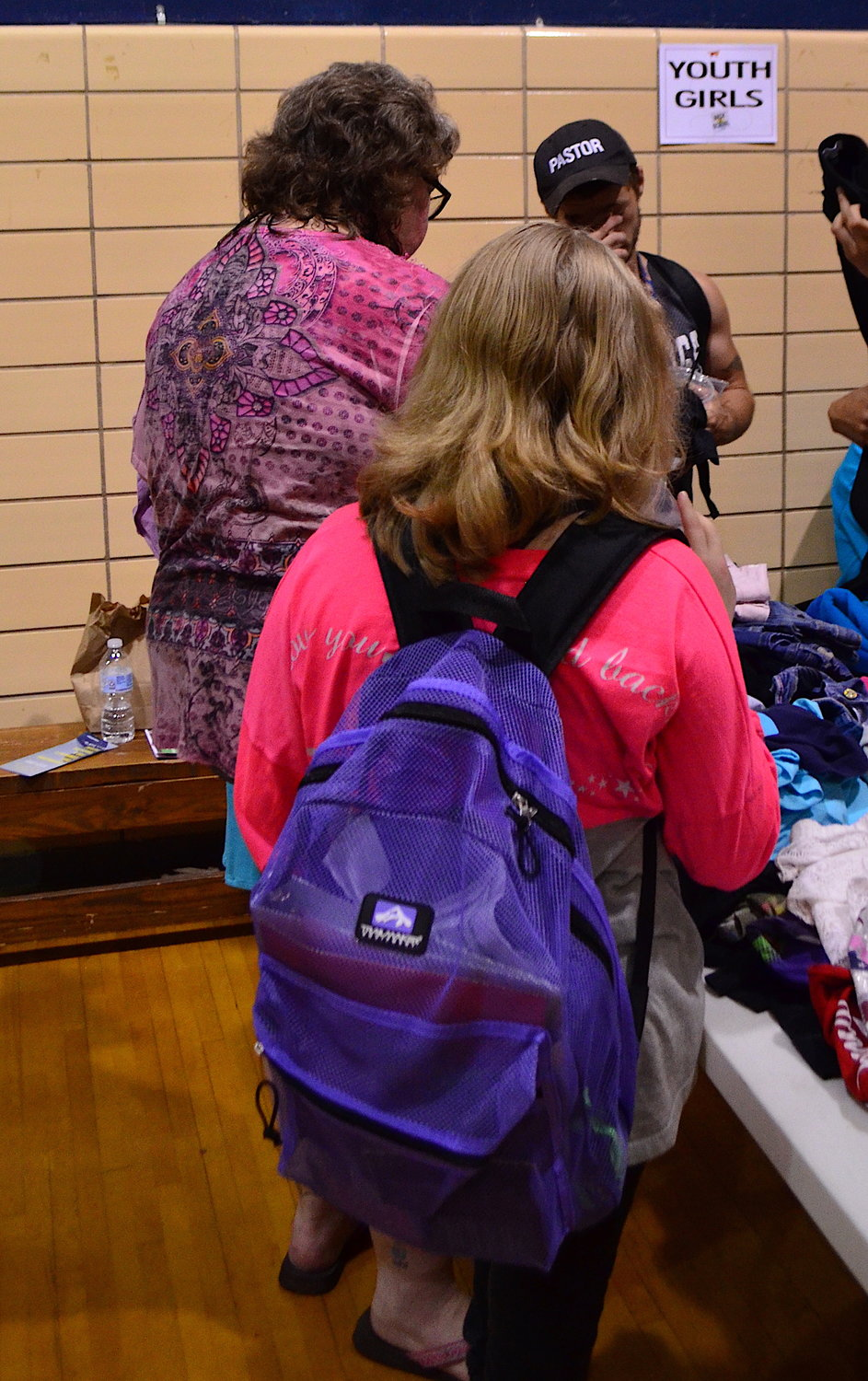 Two people browse for the perfect outfit at the City of Lights Dream Center Saturday.