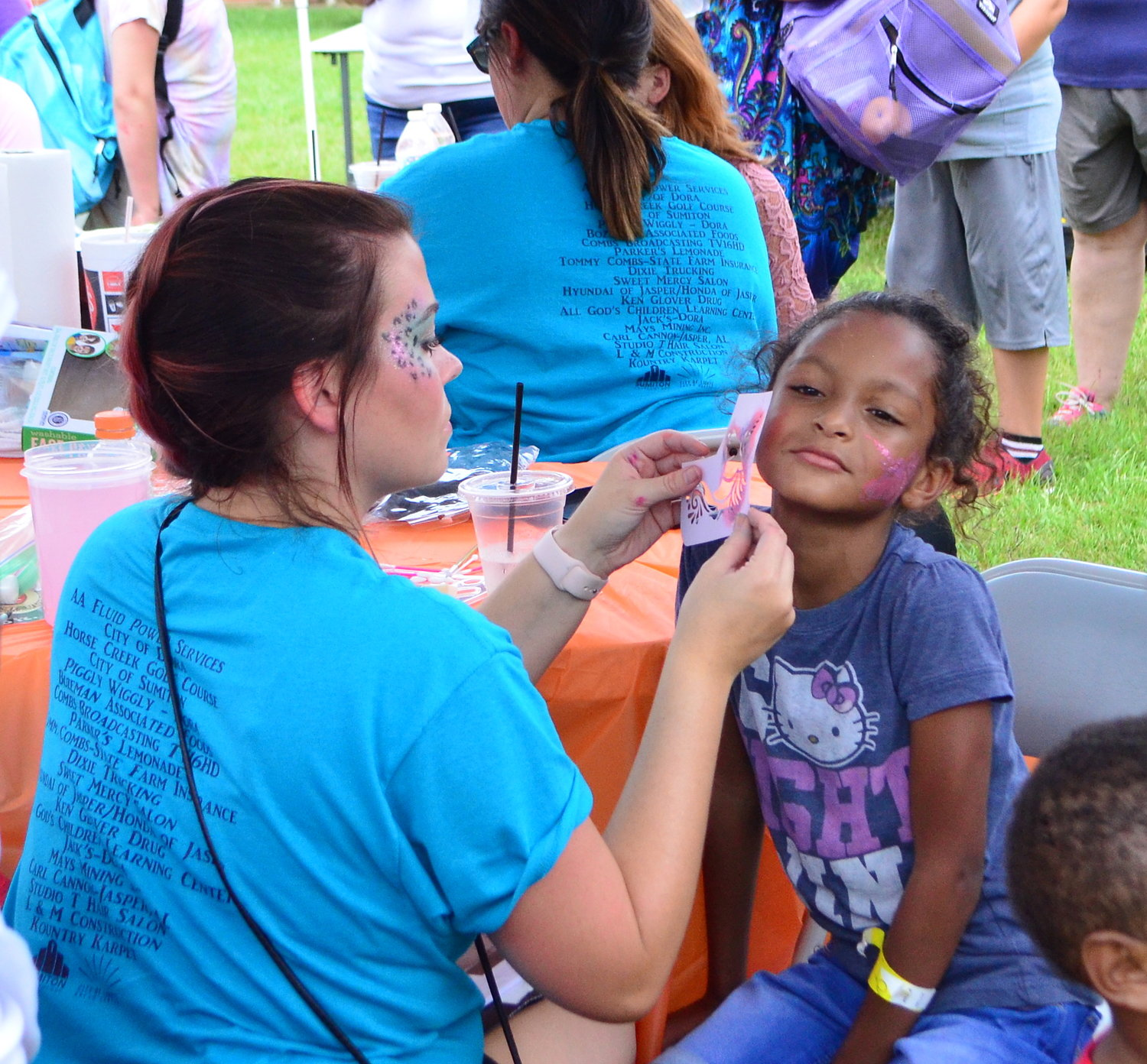 Kids enjoyed face painting and inflatables as part of the Back 2 School Bash Saturday.