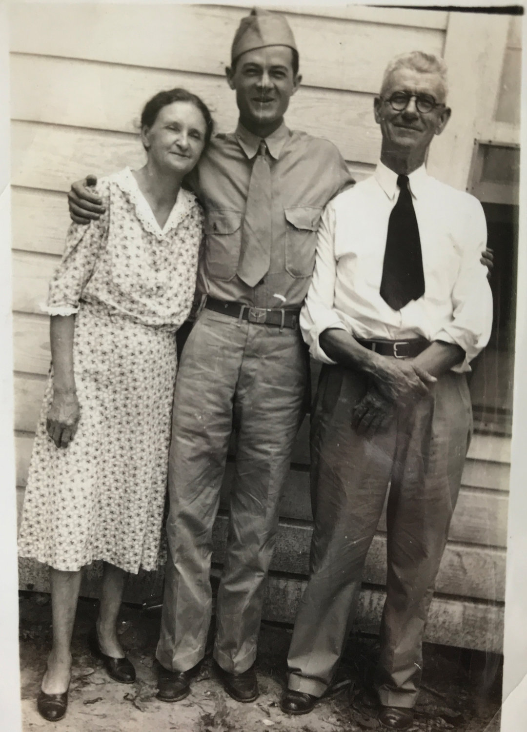 Bob Hester in uniform with his parents David and Maggie Hester during World War II.