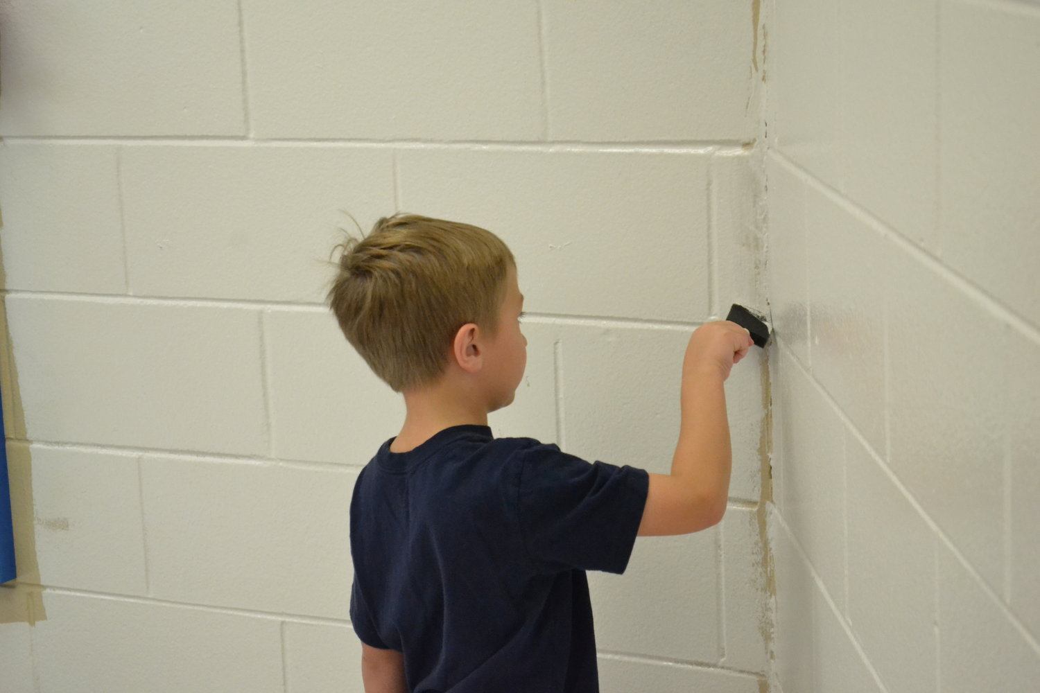 Some areas inside Parrish Elementary School received a fresh coat of paint as part of a cleanup day prior to students returning later this month.