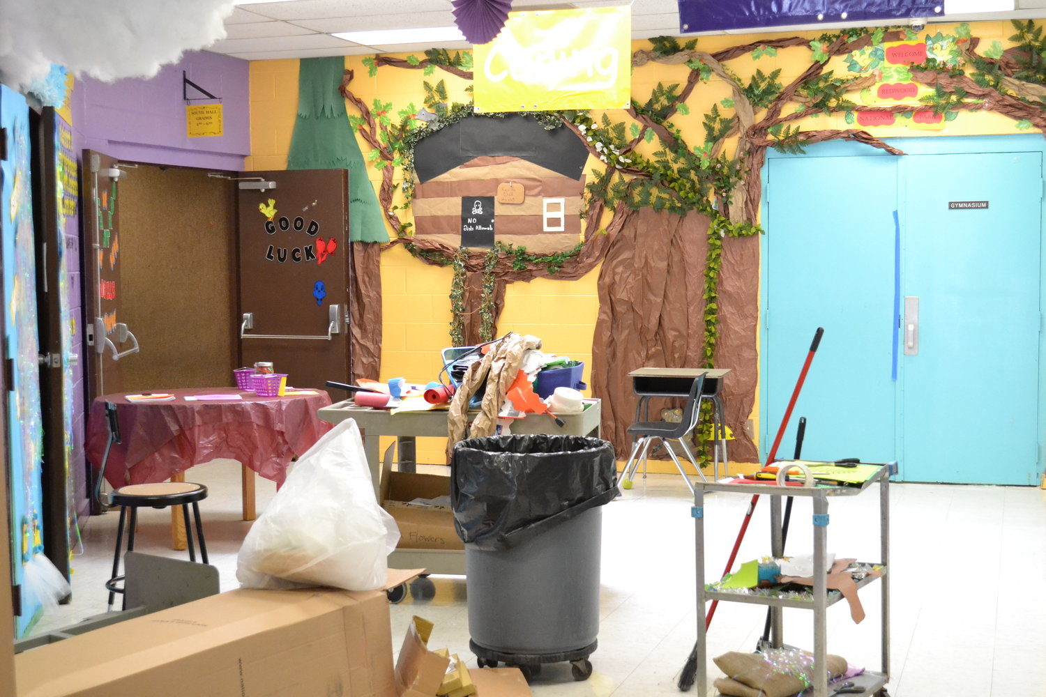 Volunteers worked Saturday cleaning up Parrish Elementary School before students return later this month.