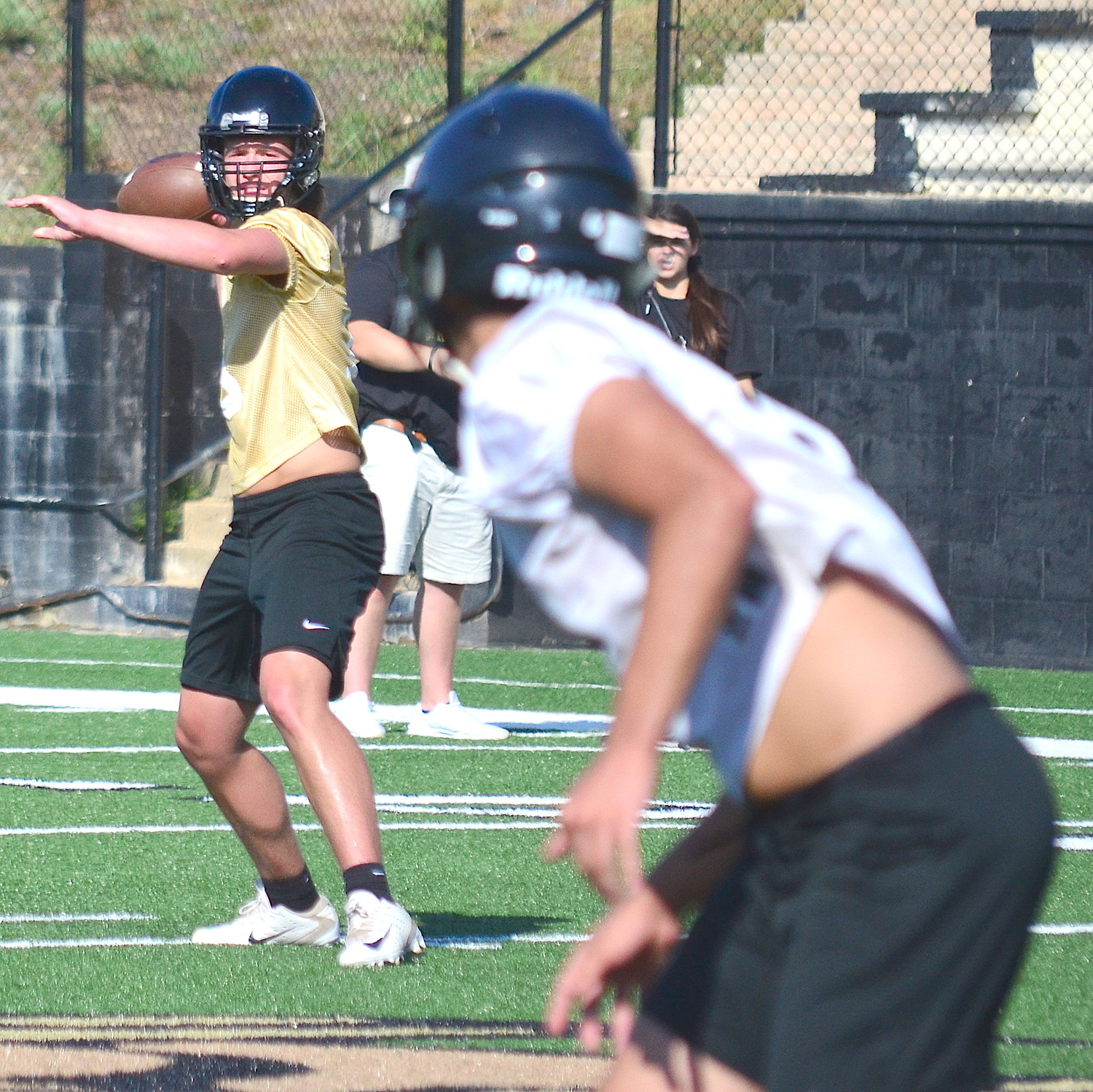 Jasper quarterback Parker Sawyer looks toward a receiver during practice on Monday this week.