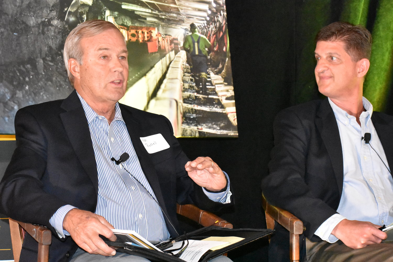 Ken Russell, left, director of workforce solutions for Bevill State Community College, speaks at a panel discussion on the Alabama coal industry Thursday at Musgrove Country Club. Philip K. Saunders, vice president of engineering for Warrior Met Coal, listens.