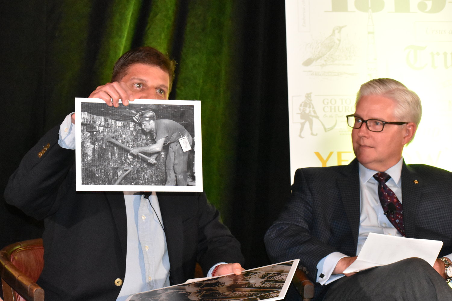 Philip K. Saunders, vice president of engineering for Warrior Met Coal, holds up an historic coal mining photo a panel discussion on the Alabama coal industry Thursday at Musgrove Country Club. Senate Majority Leader Greg Reed, R-Jasper, watches.