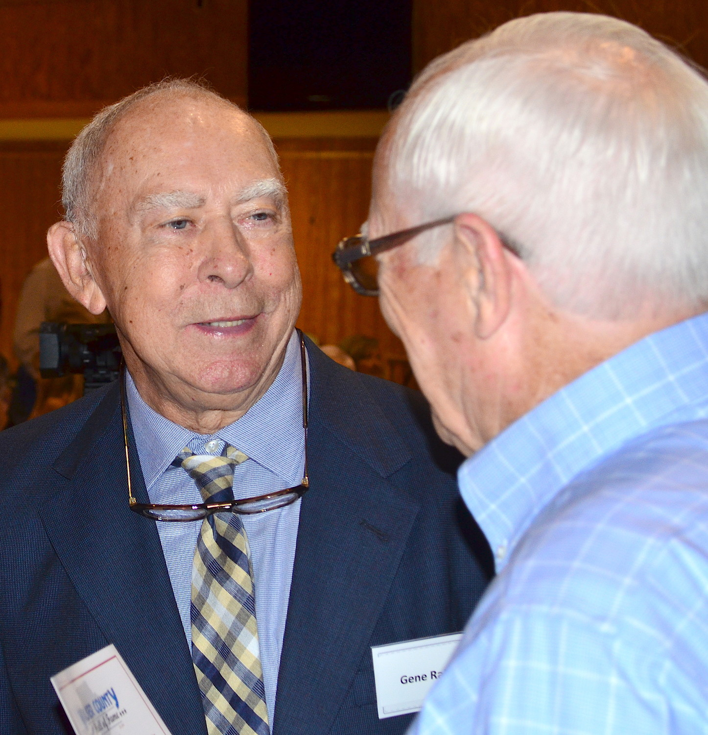Walker County Sports Hall of Fame inductee Gene Raburn talks to a well-wisher before Saturday's ceremony.
