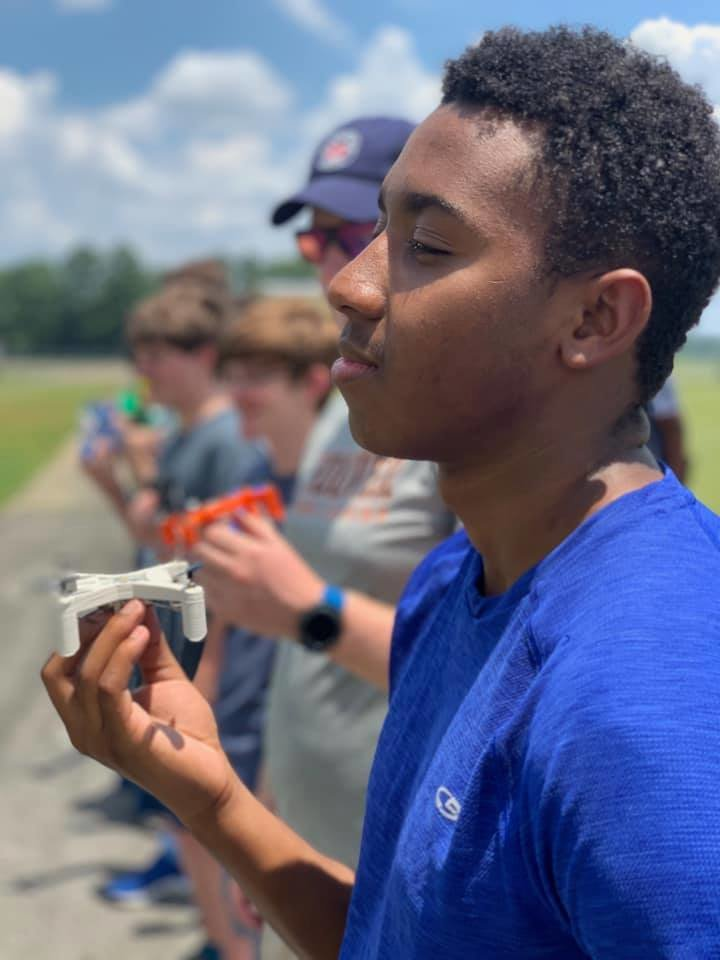A student who participated in the Southern Research Drone Academy prepares to fly a drone at Sanders Aviation in Jasper.