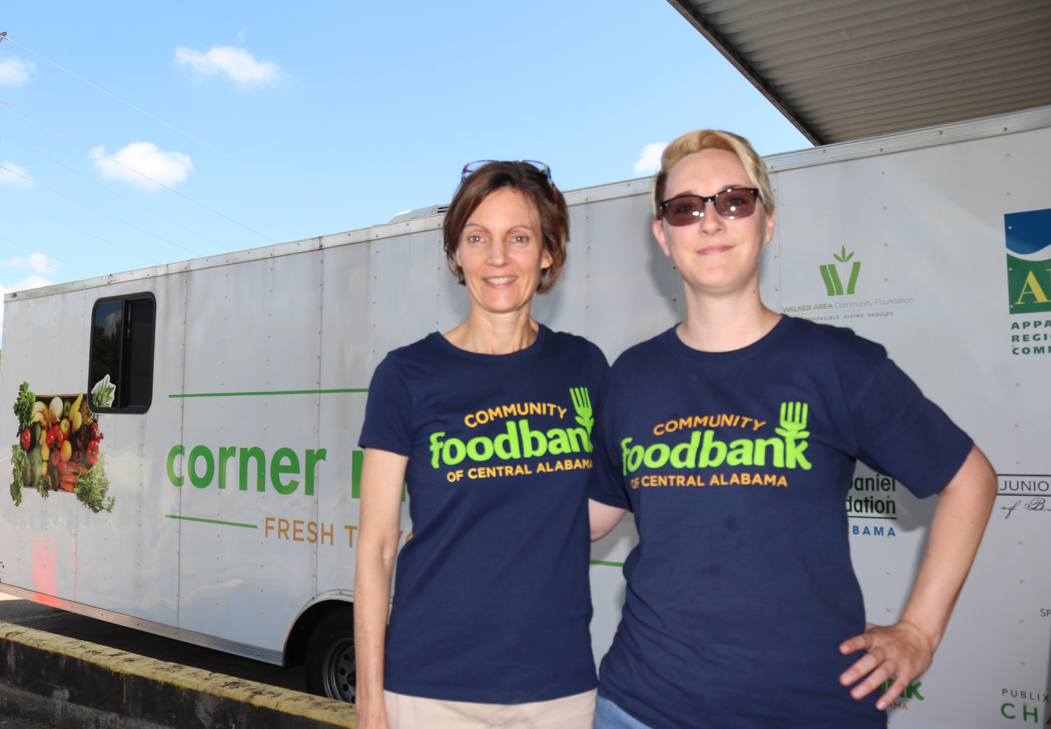 Kathryn Strickland and Jules Bailey work with the Corner Market mobile grocery story to bring healthy food choices to communities in Dora and Oakman.