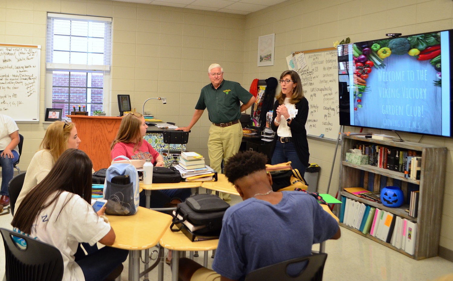 Walker County Farmers Federation President Dorman Grace and Jasper High School Assistant Principal Beth Kennedy talked to garden club students on Friday.